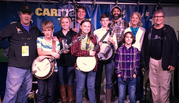 A photo of the young finalists from last year's Scott Street Five String banjo competition at the Richmond Folk Fest.