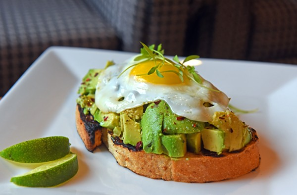 At the Graduate Richmond, a sunny-side-up egg tops chunky, salty avocado on a buttery slice of toast. - SCOTT ELMQUIST