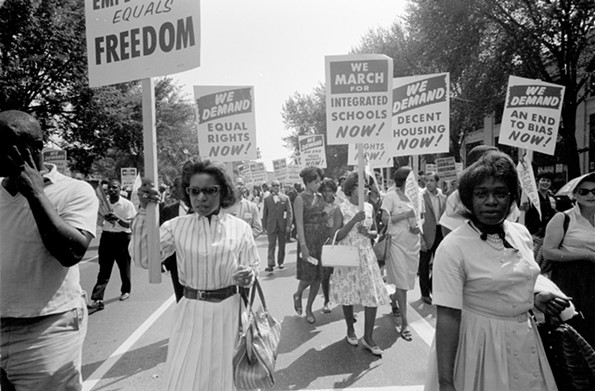 African-American protestors carried signs for equal rights, integrated schools and decent housing during the 1963 March on Washington.