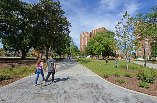 New gray-hued and oversized bricks give way to crushed stone on the walkway leading to VCU's Brandt and Rhoads dormitories. - SCOTT ELMQUIST
