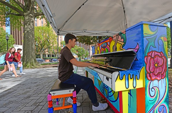 Michael Reinhardt, 18, a VCU freshman majoring in mechanical engineering, plays on a colorful piano in the park. He says it's now much easier getting from his dorm to the building that houses his classes. - SCOTT ELMQUIST