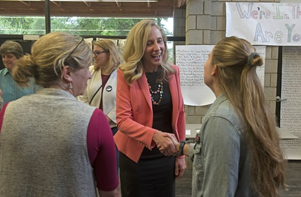 Spanberger speaks with supporters before a debate with Dan Ward at the First Unitarian Universalist Church on May 29. - SCOTT ELMQUIST