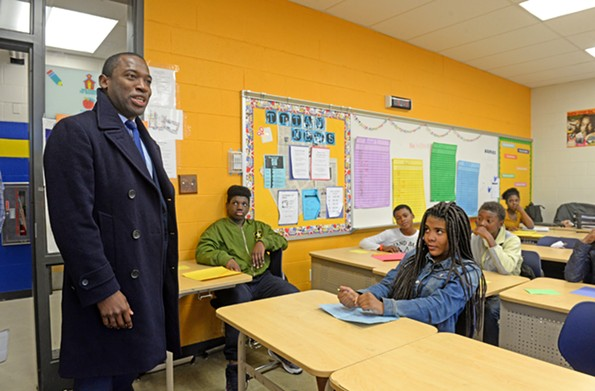 Mayor Levar Stoney visits a sixth-grade class at Martin Luther King Middle School on Nov. 16. The mayor says he›s open to school consolidation, an opinion at odds with a majority of School Board members. - SCOTT ELMQUIST
