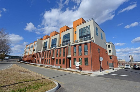 These town homes in Manchester face the James River and glare blocks visibility from the exterior, allowing enough privacy that many homeowners are keeping their windows uncovered, other than their bedrooms. - SCOTT ELMQUIST