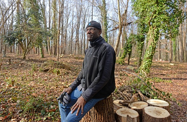 """Brian  Palmer, with the help of his wife Erin Palmer Holloway, and volunteers of the Friends of East End group, have cleared nearly half of the 12 or 13 acres of the East End Cemetery. According to the group's website, it has """"logged graves, documented headstones and connected descendants with their family, many for the first time in decades."""" - SCOTT ELMQUIST"""