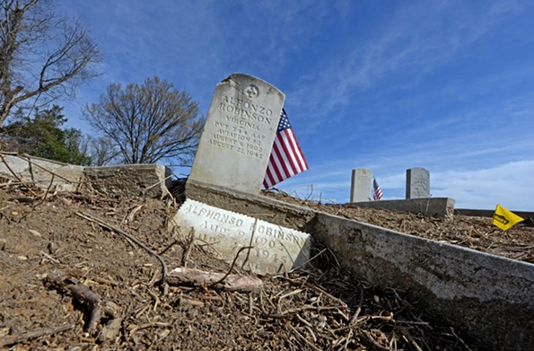 The grave of Alfonzo Robinson is in a cleared section of Evergreen Cemetery. - SCOTT ELMQUIST