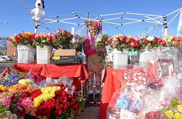 Stafford Turner's daughter Precious Turner sells flowers at Chamberlayne Avenue and Brookland Park Boulevard. - SCOTT ELMQUIST