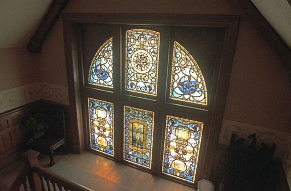 Above the grand staircase from the living hall is a two-part, 15-foot stained glass window by Tiffany Glass and Decorating Co. It was installed in 1892. - SCOTT ELMQUIST