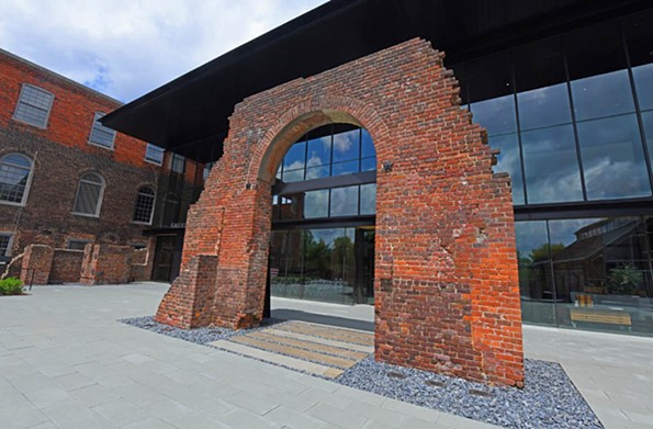A Tredegar arch has been restored to serve as a symbolic gateway to the modernist museum building. - SCOTT ELMQUIST