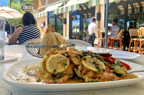 The chicken limone at Brio Tuscan Grille is served with mashed potatoes and roasted veggies. - SCOTT ELMQUIST