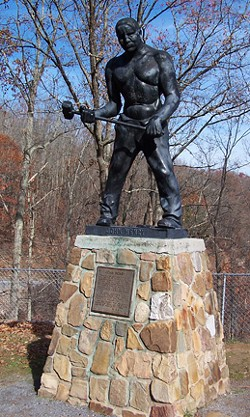 This John Henry monument is in Talcott, West Virginia. Henry was an African-American folk hero known for his prowess as a steel-drivin' man who raced a steam-powered rock drilling machine. The statue now sits near the entrance to Big Bend railroad tunnel.