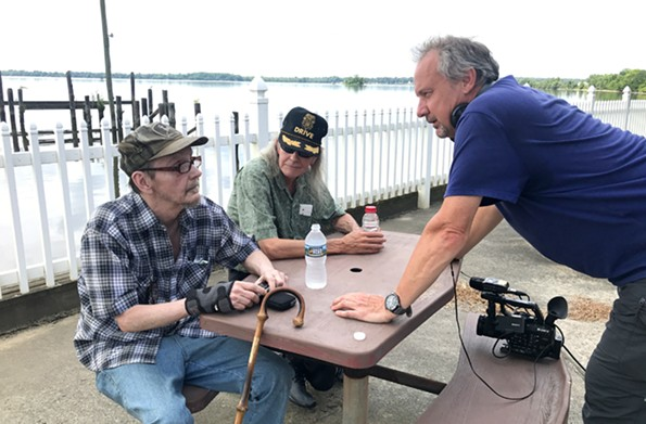 "Bernard Crutzen talks with former plant workers Frank Arrigo and Donald ""Tom"" Fitzgerald in Hopewell. - JASON ROOP"