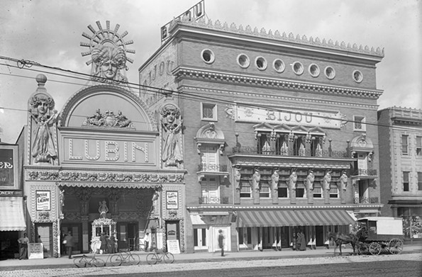 This early 20th century photograph captured bicycles and a horse-drawn wagon in front of the Lubin and Bijou theaters in the 800 block of East Broad Street. The Lubin opened in 1909 as a vaudeville house and nickelodeon. The Library of Virginia now occupies the site. - THE VALENTINE