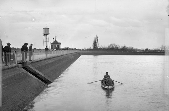 This image from about 1890 captures a rower and parkgoers at one of the lakes in the city's New Reservoir Park at the foot of Clover Street, now Arthur Ashe Boulevard. The park was renamed Byrd Park. - THE VALENTINE