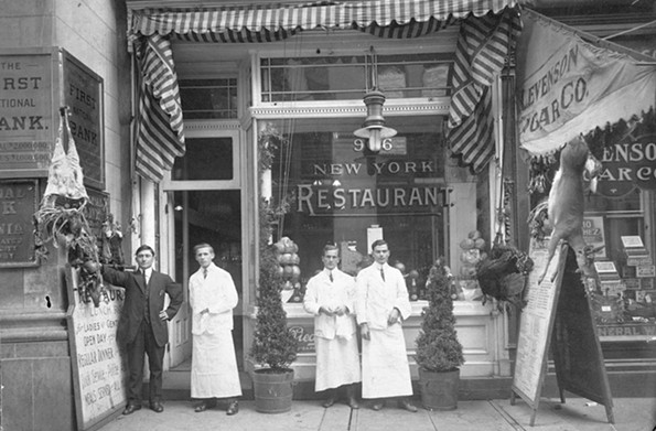 Employees of the New York Restaurant, which was at 916 E. Main St. in the financial district, break to be photographed by Cook Studio in the early 20th century. - THE VALENTINE