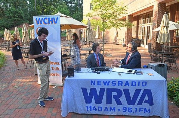 Production assistant Matthew Leibowitz listens in while Reid interviews Delegate John McGuire during the on-location broadcast at Jamestown Settlement. - SCOTT ELMQUIST