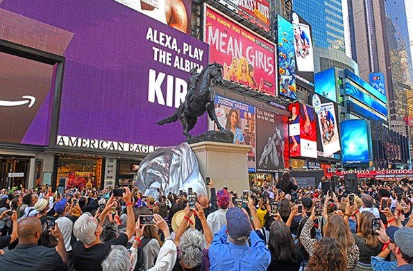 """IPhones come out in Times Square as Kehinde Wiley, behind the speakers at right, unveils his bronze monument, """"Rumors of War."""" - SCOTT ELMQUIST"""