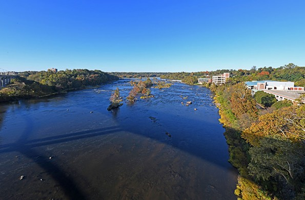A river runs through it: Richmond's picturesque 5th District is split by the James River, shown here from the Lee Bridge.  The Dominion Energy corporate headquarters is at right and the 2000 Riverside apartment complex is on the left bank. - SCOTT ELMQUIST