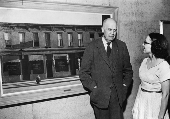 """Edward Hopper visited Richmond in 1953 to serve as a juror for a VMFA exhibition. Here he discusses his famous painting """"Early Sunday Morning"""" with local artist Bell Worsham. Hopper also served as chairman of the jury for the museum's first biennial exhibition in 1938. - VIRGINIA MUSEUM OF FINE ARTS"""