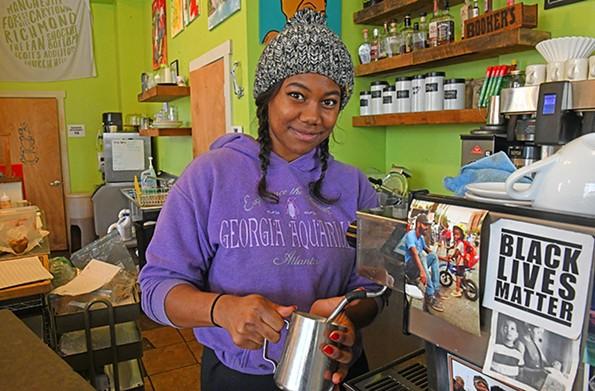Barista Shirron Jones makes a latte. - SCOTT ELMQUIST