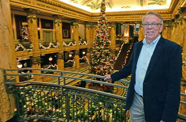 Designer J. Rick Lunsford surveys the decorated rotunda of the Jefferson during the holidays last year. - SCOTT ELMQUIST