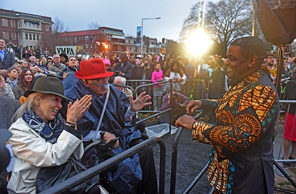 """Richmonders of the Year Pamela and William Royall, local philanthropists and art collectors, chat with artist Kehinde Wiley, whose work they have supported from early in his career, at the official unveiling of """"Rumors of War"""" on Dec. 10. - SCOTT ELMQUIST"""