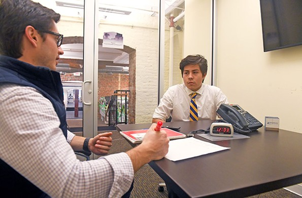 Diego Marti Vertiz, a quantitative analyst from RiverFront Investment Group, works with student Elman C. - SCOTT ELMQUIST