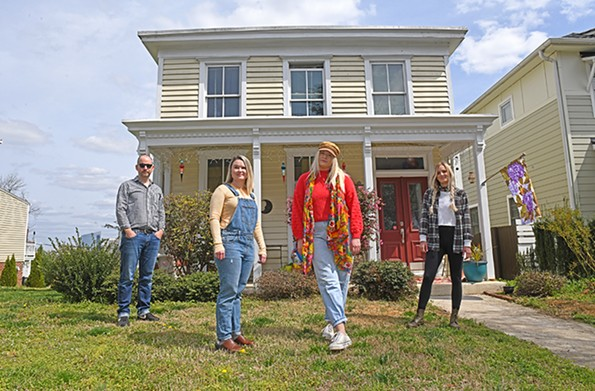 Kevin Koziol visits friends, from left, Maddie Grey, Lindsay Alls and Shannon Spicer, who share one of the oldest houses in Springhill. - SCOTT ELMQUIST