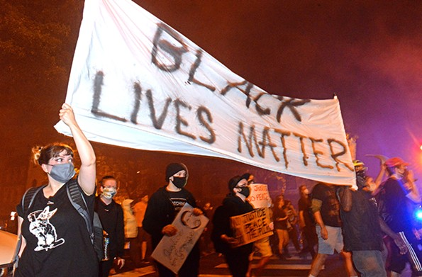 Protesters marched through Richmond streets Friday evening. - SCOTT ELMQUIST