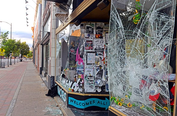 The windows of Rumors Boutique at 723 W. Broad St. were smashed during Saturday night's protest. - SCOTT ELMQUIST