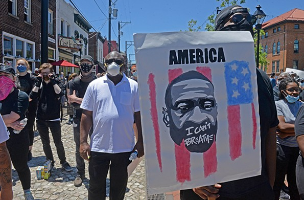 Hundreds of people gathered at a rally at 17th Street Market on Sunday where speakers pleaded for unity and justice for George Floyd. - SCOTT ELMQUIST