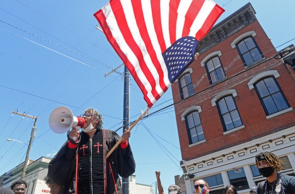 Shirley A. Snead addresses the crowd at a rally at the 17th Street Market on Sunday afternoon. - SCOTT ELMQUIST