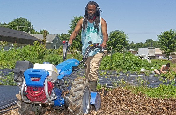 Duron L. Chavis and a steady crew of volunteers have built more than 200 raised beds during the pandemic through his organization Happily Natural Day. - SCOTT ELMQUIST/FILE