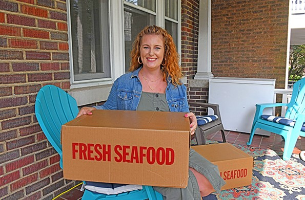 Martina James Nalley, cousin of the owner of Armory Seafood, has been taking orders in the Fan and driving to Hampton to pick up the goods. - SCOTT ELMQUIST