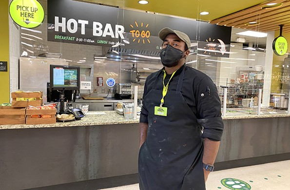 Xavier Beverly, Ellwood Thompson's new kitchen manager, is staying positive during the pandemic and channeling his energy into serving the community. - SCOTT ELMQUIST