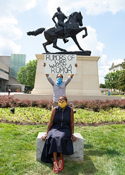 """Chambliss and VMFA curator Valerie Cassel Oliver in front of Kehinde Wiley's """"Rumors of War"""" statue in a more recent photo provided by the museum. - DAVID STOVER © VIRGINIA MUSEUM OF FINE ARTS"""