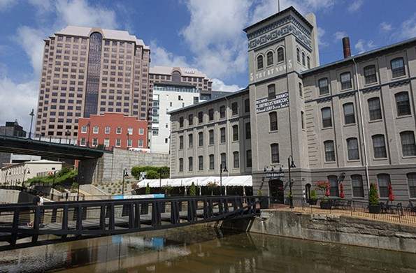 Pedestrian activity was subdued on a recent morning at the Locks, a mixed-use office, residential and restaurant complex in the financial district along the historic James River & Kanawha Canal and the Haxall millrace. - SCOTT ELMQUIST