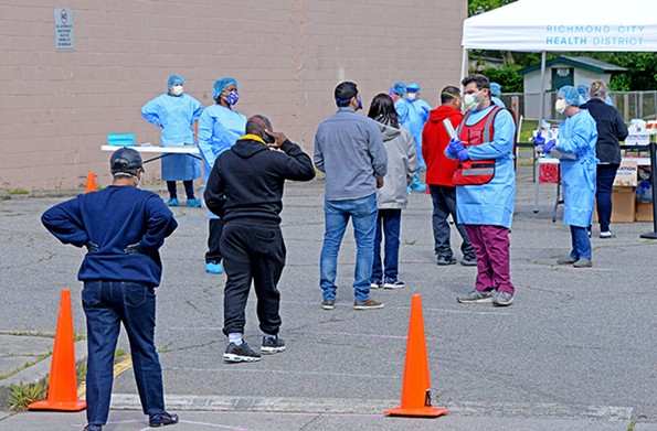 A team of health care workers from the Virginia Medical Reserve Corps administers COVID-19 tests near Creighton Court on April 28. - SCOTT ELMQUIST/FILE