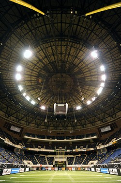 The shallow, saucer-shaped dome, 125 feet above the arena floor, crowns one of Richmond's most architecturally breathtaking interiors. - SCOTT ELMQUIST/FILE