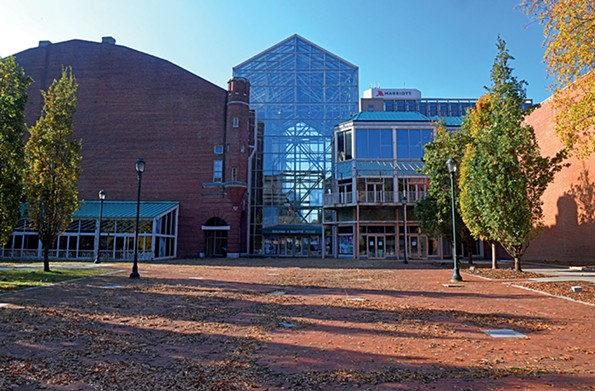 If a glass-enclosed former food court next to the arena is demolished,the architecturally distinctive brick Blues Armory, at left, can be adapted for new uses in the redevelopment plan now being formulated for the Coliseumarea. - SCOTT ELMQUIST/FILE