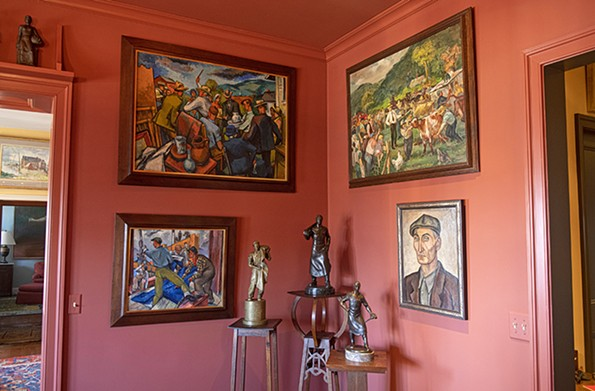 """In the dining room. intimatesculptures placed atop arts and crafts-inspired bases share a corner with four paintings. Counterclockwisefrom top left: """"TheAuction,"""" 1938, and """"Reading the Blueprint,"""" (no date) both by Frederick Bushhoz; """"Portrait of a WPA Worker"""" (1936) by Burr Lee Singer; and """"The Auction"""" by Cecil Bell. - SCOTT ELMQUIST"""