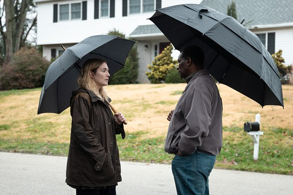 """Kate Winslet as Police Detective Mare Sheehan talks to stern Police Chief Carter, played by John Douglas Thompson, in HBO's """"Mare of Easttown,"""" a highly watchable seven-part series starting this Sunday at 10 p.m."""