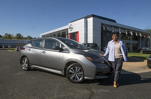 Kenya Reid, a saleswoman at Hyman Bros. Nissan, says there is increased interest in electric vehicles lately. - SCOTT ELMQUIST
