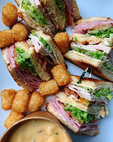 The Club with tater tots from Fat Kid Sandwiches. - @CLUBMEMBERSONLYRVA