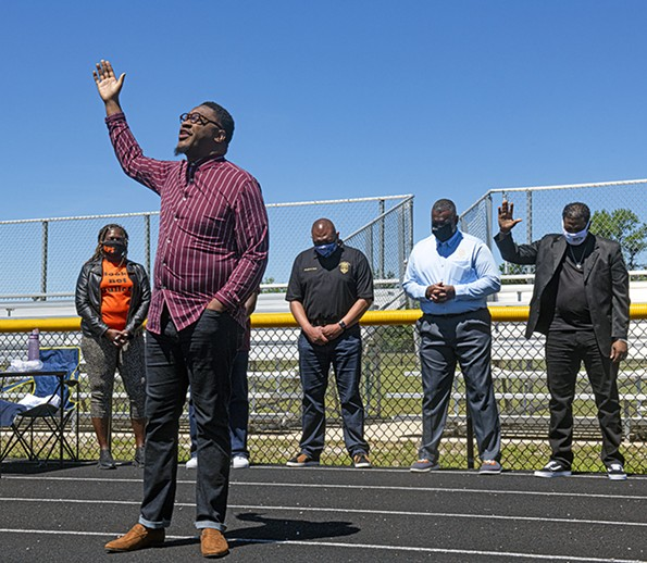 During an anti-gun violence rally on May 1, McCutchen speaks in front of the Henrico and Richmond police chiefs at George Wythe High School. The Men in Action rally was in response to the killings at the Belt Atlantic Apartments that claimed the lives of Sharnez Hill and her 3-month-old daughter, Neziah. - SCOTT ELMQUIST