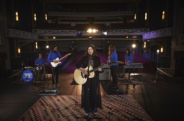 """Onstage at the Virginia Repertory Theatre, Dacus and her band filmed a performance of """"Hot & Heavy"""" for an April episode of """"The Late Show with Stephen Colbert."""" - JORDAN RODERICKS"""