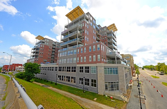"At 800 Semmes Ave. at the south end of the Manchester Bridge, distinctive roofline ""sails"" mark the Terraces at Manchester, developed by Urban Development Associates. - SCOTT ELMQUIST"