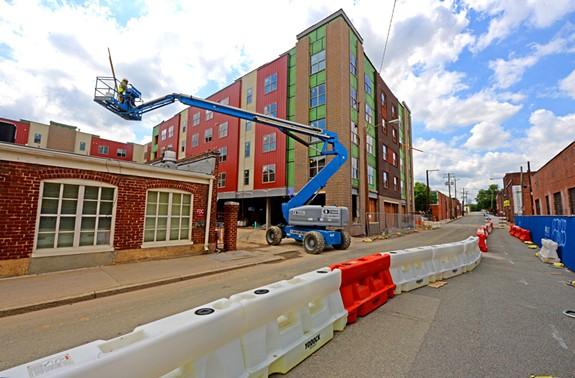 Hatcher Tobacco Flats — a 152-unit development by Genesis Properties, is under construction between 151 W. Commerce Road and West Seventh Street. - SCOTT ELMQUIST