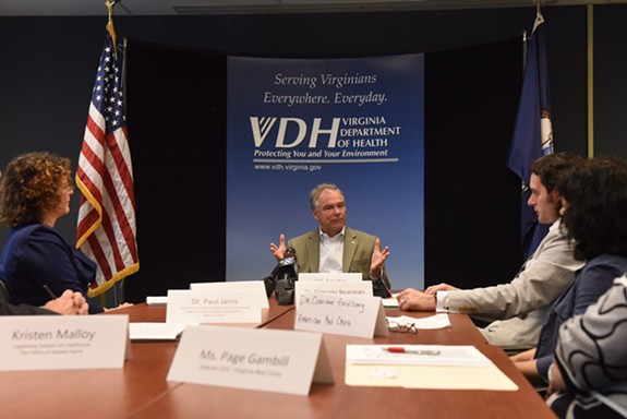 Sen. Tim Kaine discusses issues surrounding the zika virus with officials at the Virginia Department of Health in Richmond on Monday morning. - SCOTT ELMQUIST