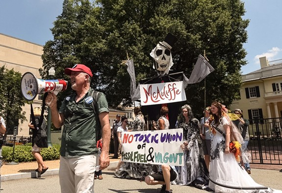 """Tidwell, with fossil fuel """"brides"""" and a mockup of Terry McAuliffe, addresses the demonstration. - SCOTT ELMQUIST"""
